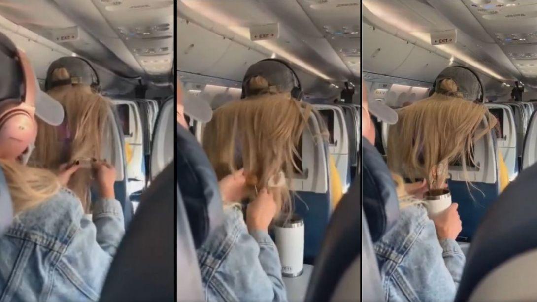 Le-pega-un-chicle-en-el-cabello-por-no-dejar-ver-la-pantalla-en-el-avion